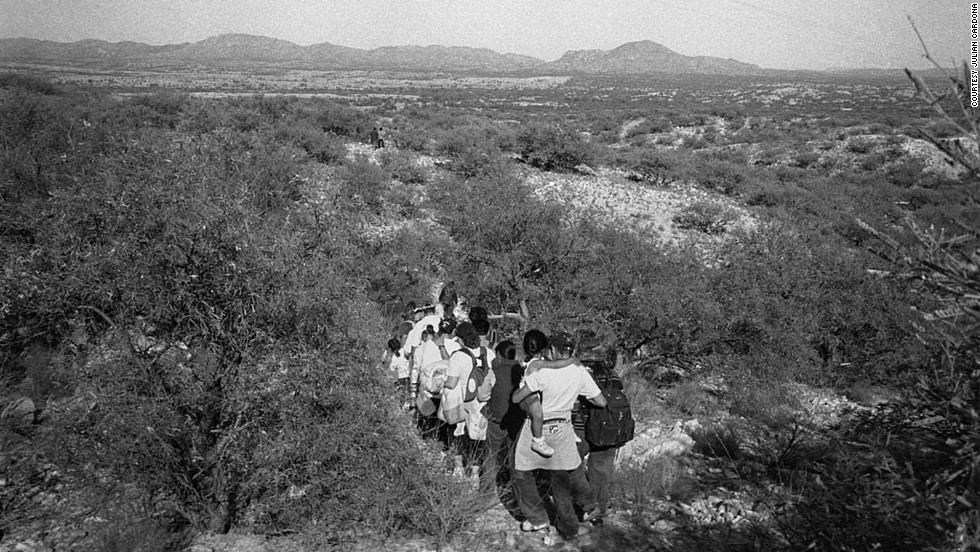 People cross the border in Sasabe, Arizona. A large number of immigrants cross the border in this mountainous area that has become the preferred spot to enter the United States.