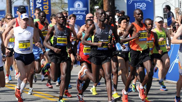 Boston Marathon runners, organizers adjust as rains greet ...