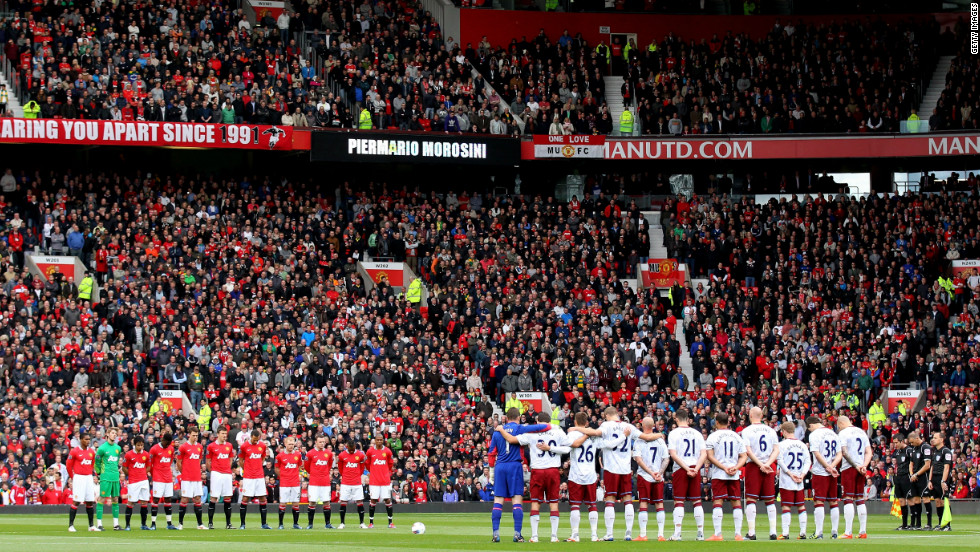Manchester United and Aston Villa players bow their heads in silence during a one-minute tribute to Morosini before Sunday's English Premier League match at Old Trafford.