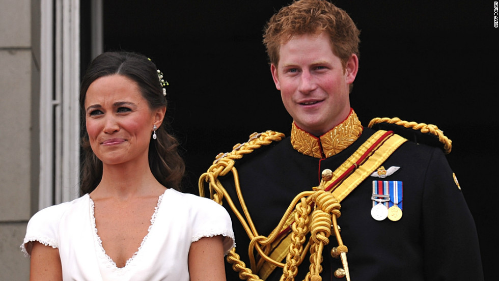 Middleton appears with best man Prince Harry on the balcony at Buckingham Palace after the royal wedding on April 29, 2011.