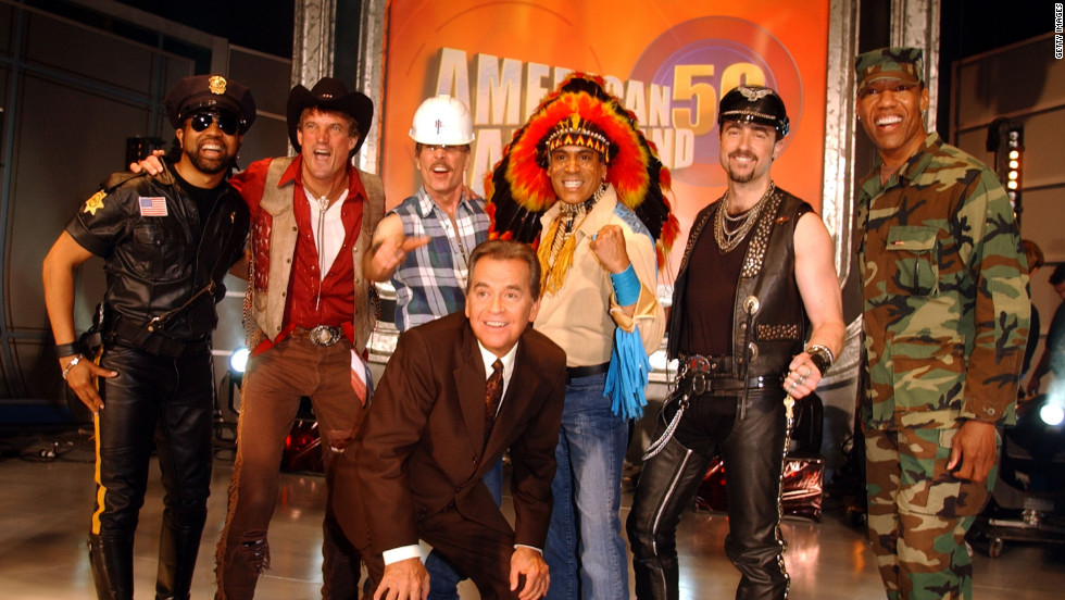 "Clark poses with ""The Villiage People"" at the taping of the 50th anniversary special of ""American Bandstand."""