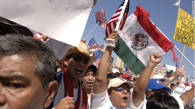 Protesters wave American flags and flags of their nations of origin at an immigration rally in Dallas in 2009.