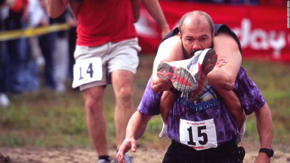 "Those looking for a shorter race might be interested in the <a href=""http://www.sundayriver.com/Events/Main/Summer/Wife_Carrying_Championship.html"" target=""_blank"">Wife Carrying Championship</a> held at the Sunday River ski resort in Maine during Fall Festival Weekend. The 278-yard dash is usually won by a couple using the ""Estonian carry,"" seen here."