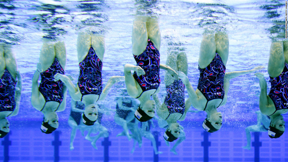 The U.S. synchronized swimming team practices its technical routine during an Olympic qualifying competition Thursday at the Aquatics Centre in the Olympic Park in London.