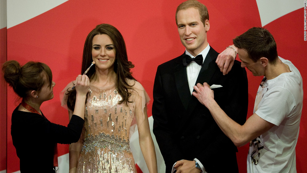 Employees put the finishing touches to new waxwork statues of Britain's Prince William and Catherine, Duchess of Cambridge, as they are unveiled at Madame Tussauds in Blackpool on Thursday.