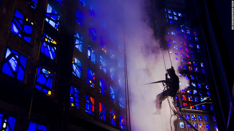 Industrial climbers clean window elements of the Kaiser Wilhelm Memorial Church in Berlin, Germany, on Thursday. More than 16,000 glass mosaics are being washed with hot water high-pressure cleaners.