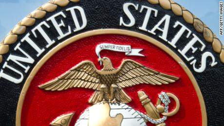 The US Marine Corps logo is seen March 9th, 2012, at the US Marine Corps Base Quantico shortly before USMC officials deliver a briefing on the Active Denial System, a US DoD non lethal weapon that uses directed energy and projects a beam of man-sized millimeter waves up to 1000 meters that when fired at a human, delivers a heat sensation to the skin and generally makes humans stop what they are doing and run.