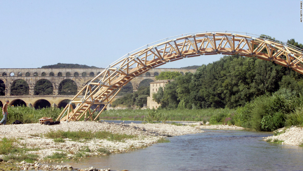 Shigeru Ban has created a host of landmarks made partly from cardboard including this bridge near the Pont du Gard, in Vers-Pont-du-Gard, southern France.
