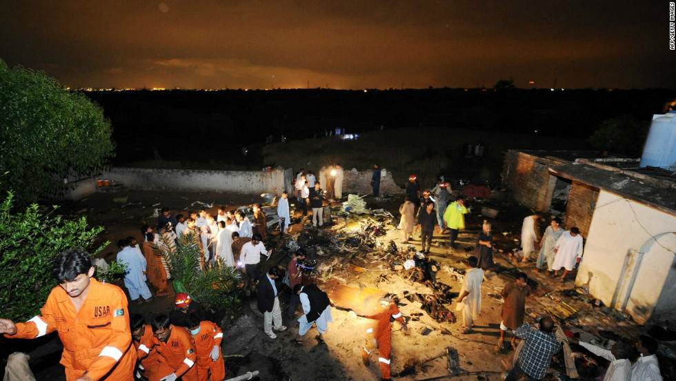 "Pakistani rescue workers and local residents search the site of a plane crash in Rawalpindi on Friday, April 20. There is ""no chance"" of any survivors after a plane carrying up to 130 people crashed while trying to land in bad weather near Islamabad, police said."