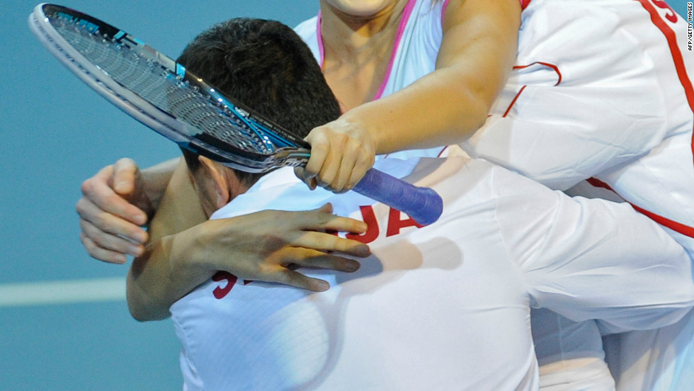 Serbia's Bojana Jovanovski celebrates her victory with coach Dejan Vranes after she helped to beat Belgium in Charleroi.