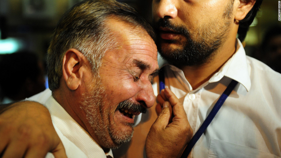 Pakistani relatives of a victim of a plane crash near Islamabad mourn at the airport in Karachi.