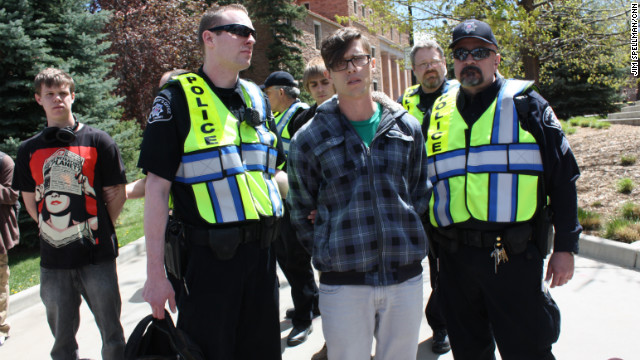 Students at University of Colorado-Boulder protest a crackdown by the school aimed at stopping a yearly marijuana smoke in. Boulder sheriffs deputies arrested 3 students and led them away in plastic handcuffs.