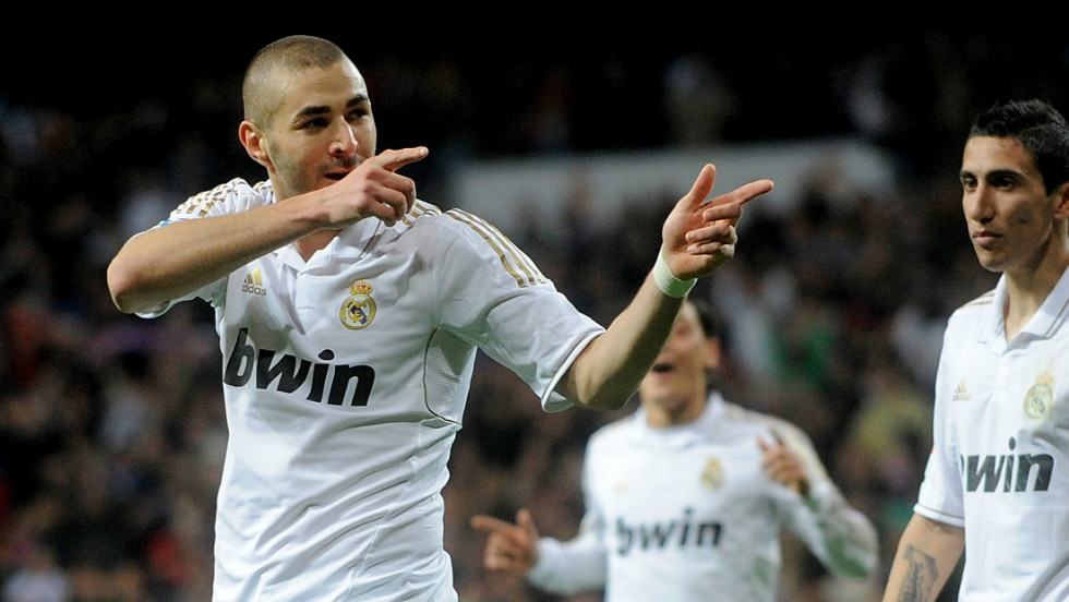 Karim Benzema celebrates his goal in Real Madrid's win over Sporting Gijon last Saturday which kept the La Liga leaders four points clear of arch-rivals Barcelona.