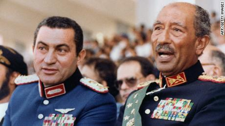 Egyptian vice President, Gen. Hosni Mubarak (L) and late President Anwar Sadat (R), both dressed in military honour uniforms, attend a military parade, 06 October 1981, in Cairo, commemorating Victory Day. Moments after, a group of military Islamist fundamentalists with allegiance to the Al-Jihad group killed Sadat in a shooting spree. Following Sadat's assassination Mubarak was sworn in as Egypt's fourth president, a position of power he has since retained, being re-elected five times. AFP PHOTO/- (Photo credit should read AFP PHOTO/AFP/GettyImages)