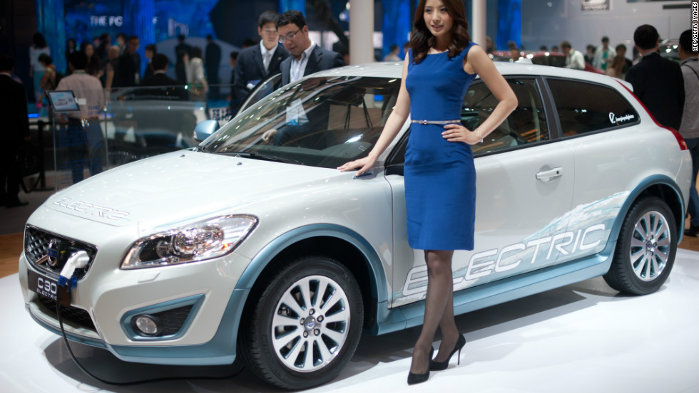 A model stands with a Volvo 'C-30' electric car at the Auto China 2012 car show in Beijing.