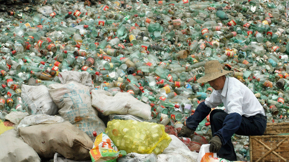 A worker packs recyclable bottles at a dump in the city of Changde in Hunan Province in southeastern China. China has increased efforts to recycle of waste materials as part its efforts to reduce pollution and protect limited natural resources.