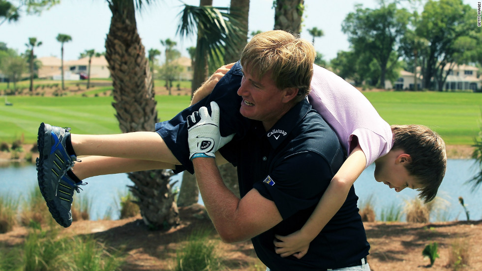 The former world No. 1swings his son Ben over his shoulder during the fourth annual Els for Autism Pro-Am charity golf tournament, held in March 2012.