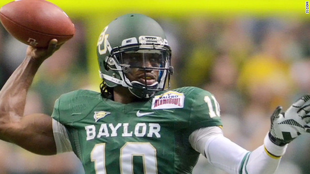 Baylor quarterback and 2012 Heisman Trophy winner Robert Griffin III drops back to pass