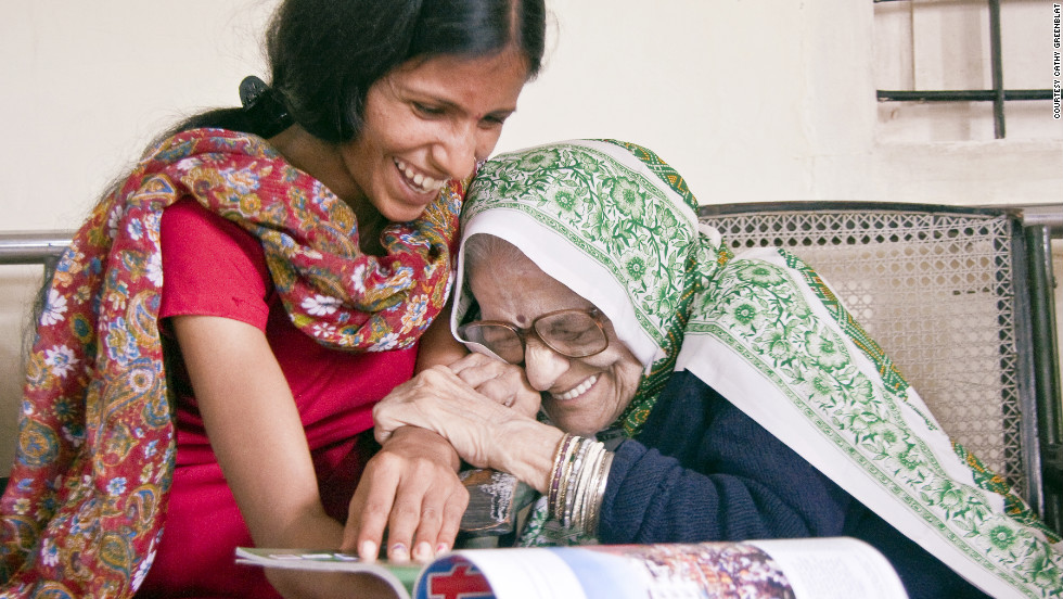 In India, Didi arrived at this day care center depressed and using a wheelchair. Now she's more cheerful and walks with little assistance. Didi enjoys a moment with caregiver Ashwani.