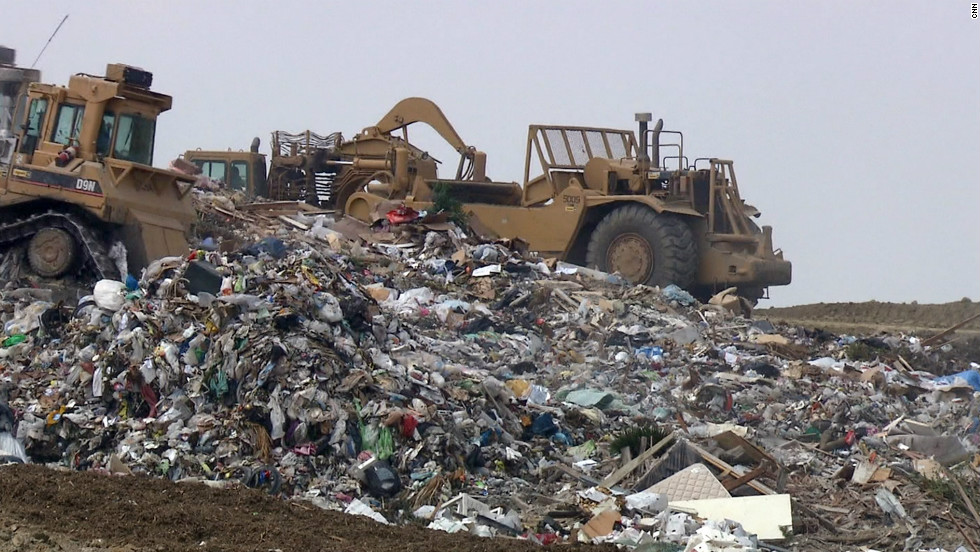 Compacting trucks assemble the latest delivery to L.A.'s Puente Hills Landfill, the largest rubbish dump in America. Despite surface appearances, Puente Hills is considered one of the most state-of-the-art landfills in the world. Some aren't so well maintained.