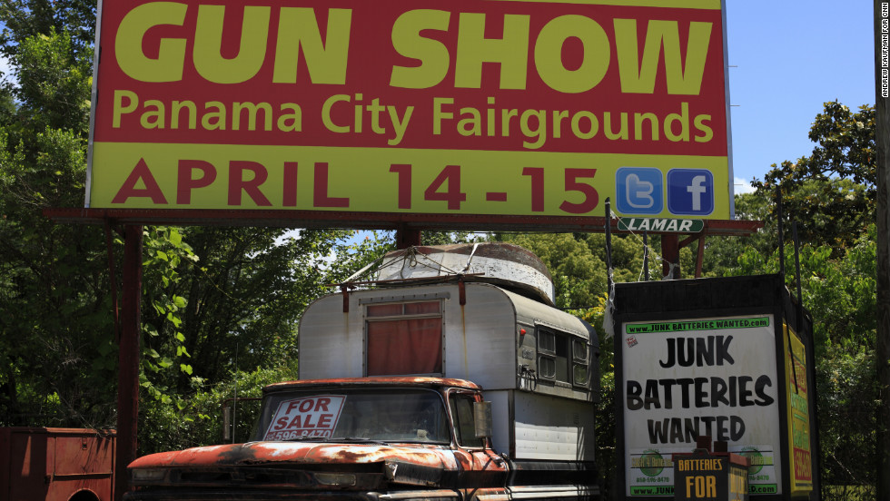 Billboards advertising gun shows and pawnshops are common along the highways of the Florida Panhandle. The state has some of the strongest gun rights laws in the nation.