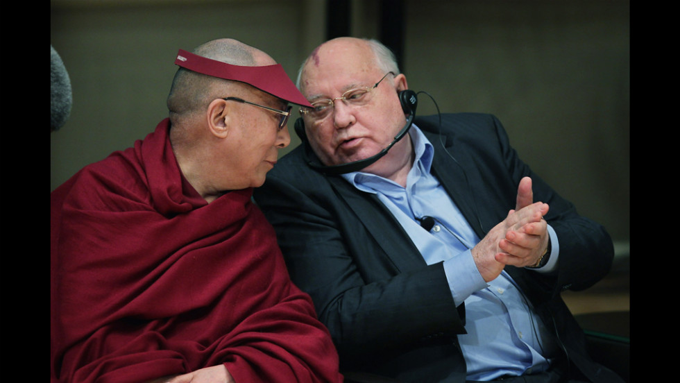 His Holiness the Dalai Lama, left, and former Soviet President Mikhail Gorbachev participate in a panel discussion during the World Summit of Nobel Peace Laureates at the Chicago Symphony Orchestra Hall on Wednesday.