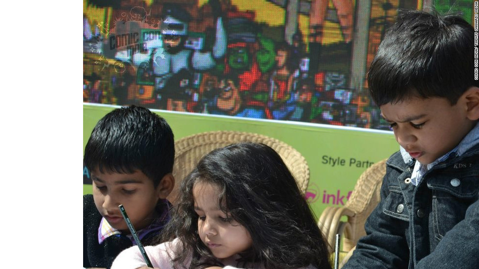 Children take part in a comic drawing contest at the 2nd Annual Comic Con India.