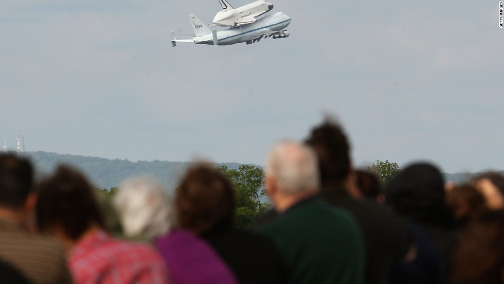 People watch as the 747 takes off with the shuttle at Washington Dulles International Airport on Friday.