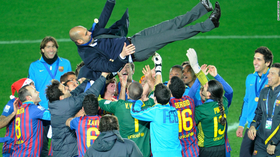 He was massively popular at the Camp Nou after four trophy-laden seasons. Here he is thrown in the air by his players after winning the FIFA Club World Cup for the second time in December 2011, having been the first team from Spain to win it two years earlier.