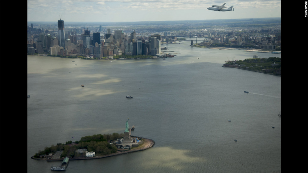 The space shuttle Enterpise flies over the Hudson River.
