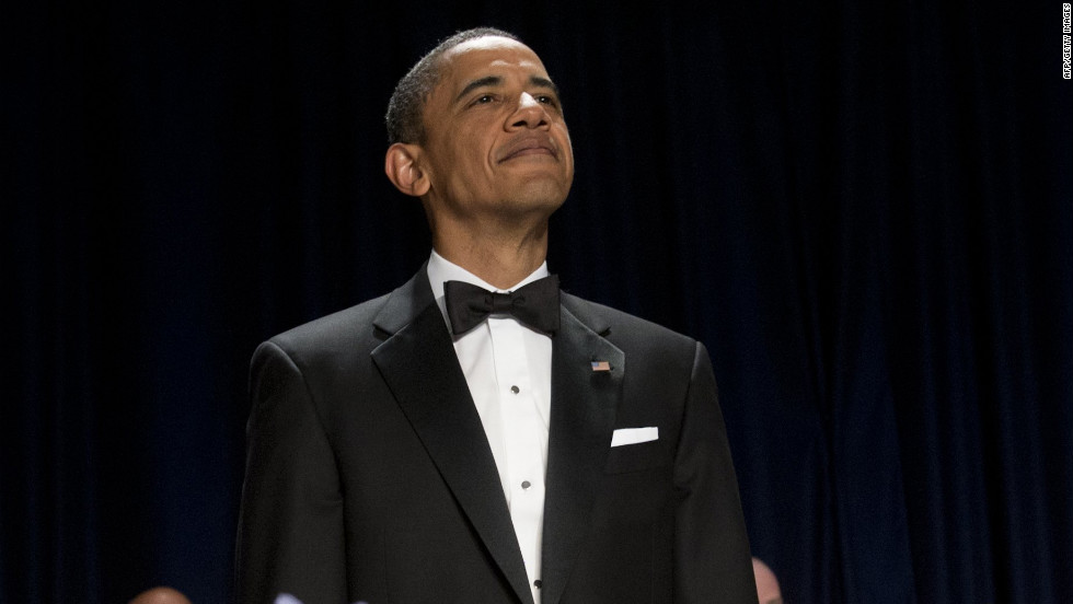 President Barack Obama stands during the opening of the White House Correspondents' Association Dinner on Saturday, April 28, 2012.