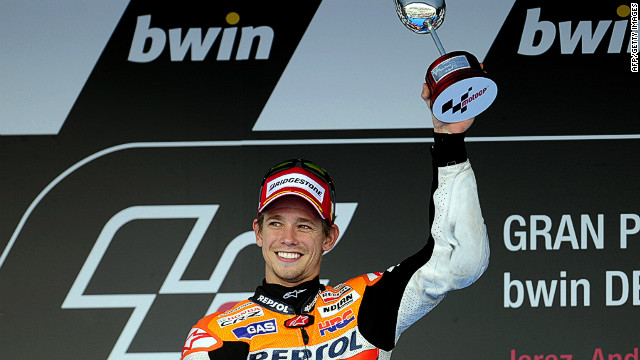 Casey Stoner of Australia celebrates his first win at the Spanish MotoGP on Sunday