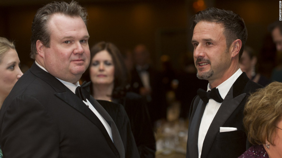Actors Eric Stonestreet, left, and David Arquette dressed in tuxes during the dinner.