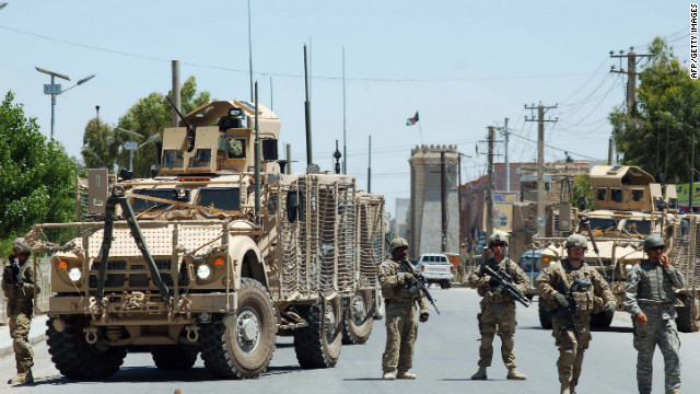 U.S. soldiers stop traffic on the road to the governor's compound in Kandahar, scene of a deadly battle on April 28.