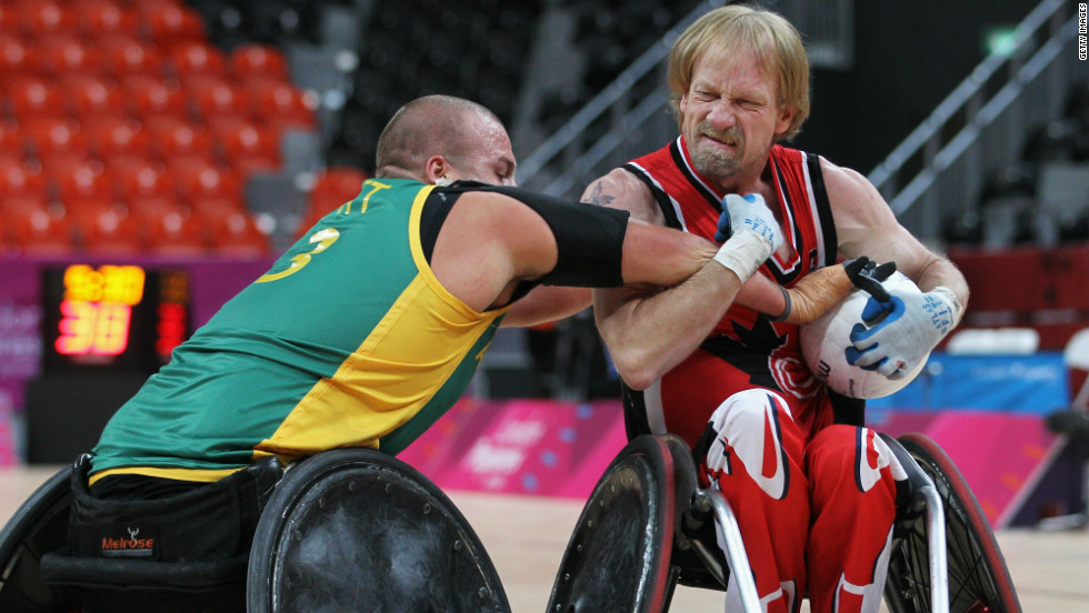 Garret Hickling, right, wrestles with an opponent during Canada's losing clash to eventual winners Australia at the Paralympic test event in London.