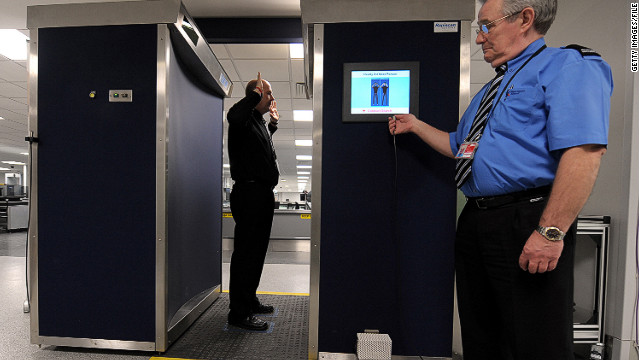 A security officer demonstrates the body scanner at the airport in Manchester, England, in 2010.