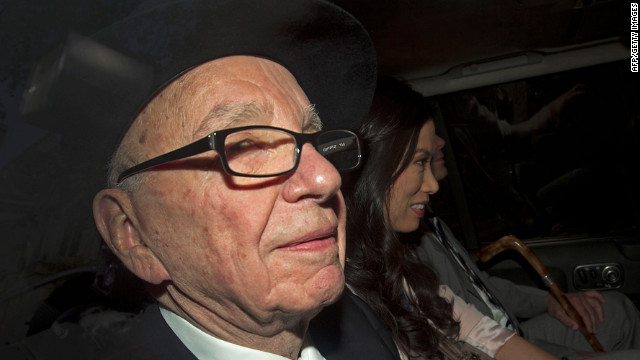 Rupert Murdoch is driven away from the High Court in London after giving evidence at the Leveson Inquiry.