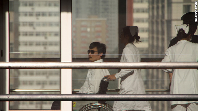 Chinese activist activist Chen Guangcheng is seen in a wheelchair at the Chaoyang hospital in Beijing on May 2, 2012.