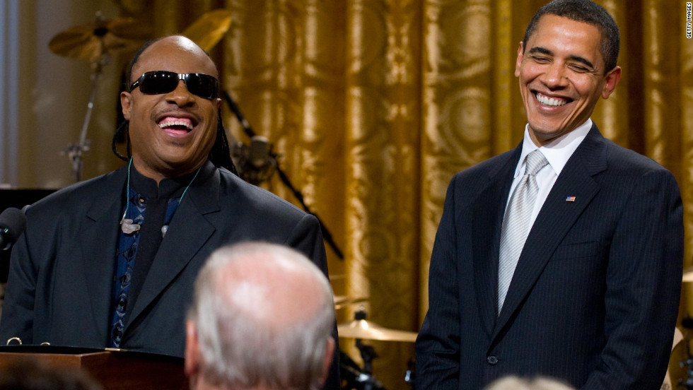 Musician Stevie Wonder laughs with Obama during a performance at the White House on February 25, 2009. Wonder was awarded a Library of Congress Gershwin Prize for Popular Song.