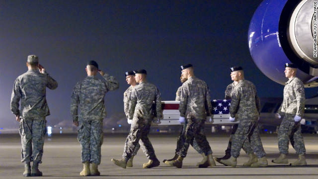 A U.S. Army carry team transfers the remains of Army Capt. Bruce K. Clark at Dover Air Force Base, Delaware, on Thursday.