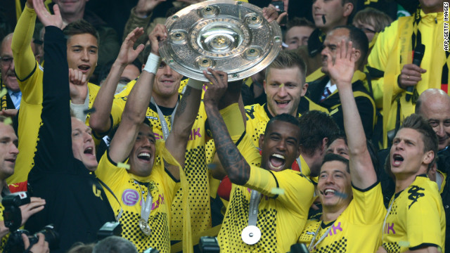 Dortmund's players lift the Bundesliga trophy after beating Freiburg 4-0 at home on Saturday.