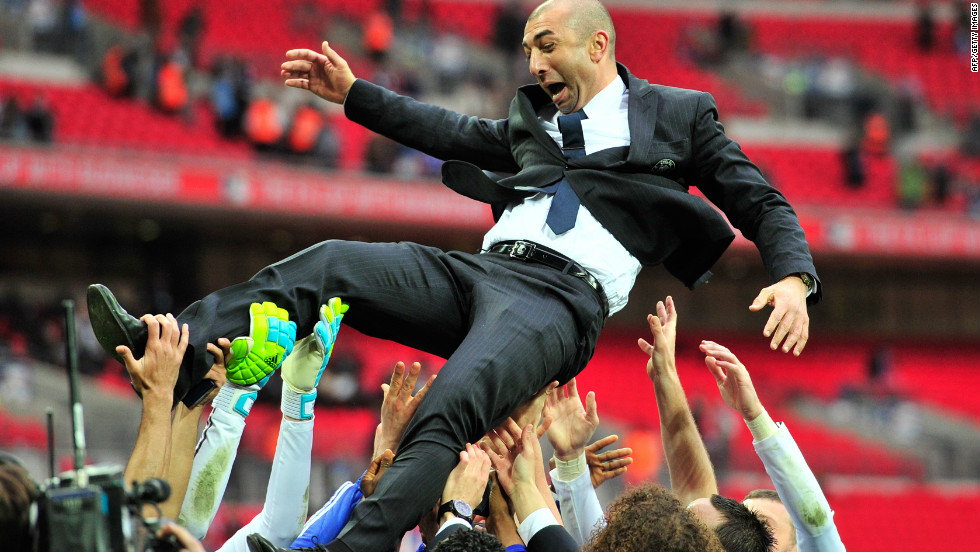Chelsea's caretaker manager Roberto Di Matteo is thrown into the air in celebration by his players after their 2-1 victory against Liverpool at London's Wembley Stadium.
