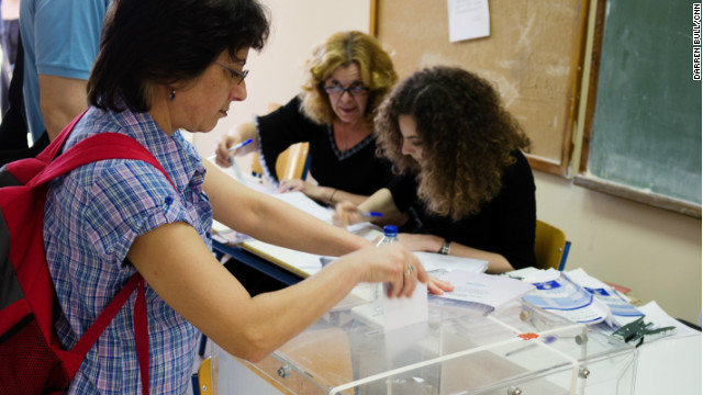 Voters cast their ballots in Greece's general election at a polling station in Athens on Sunday May 6, 2012.