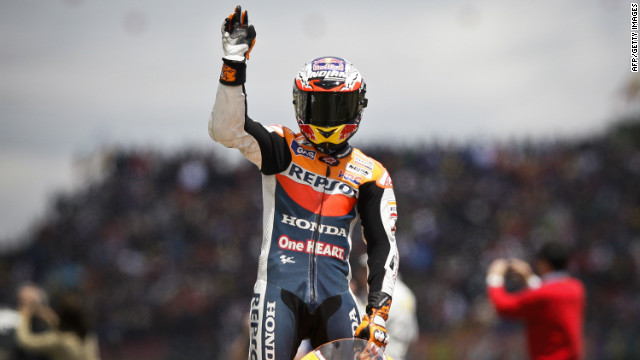 Casey Stoner wins the Portuguese MotoGP, the first time he's won at Estoril