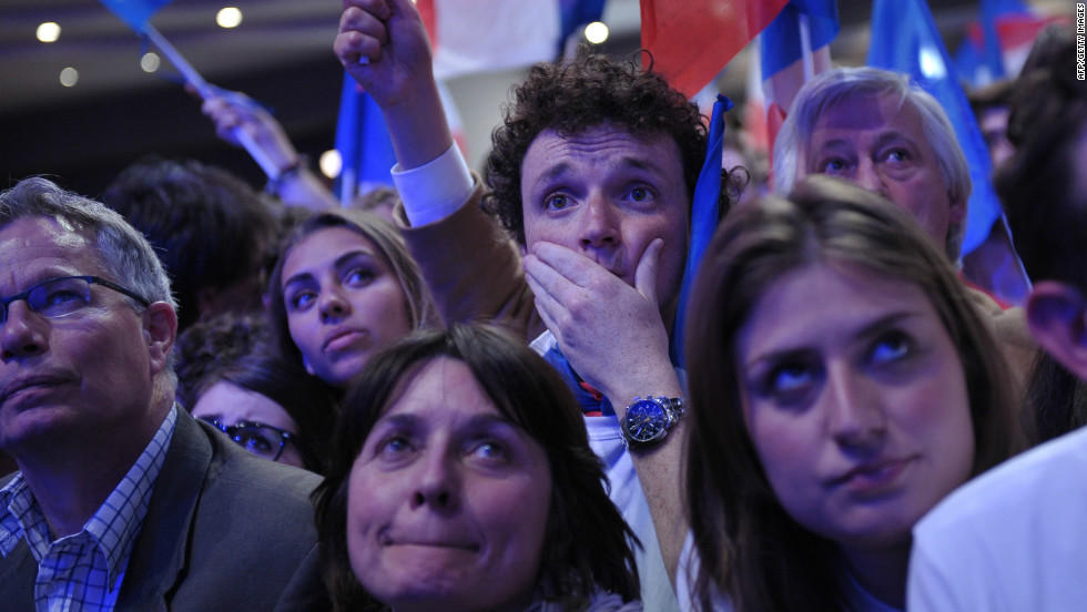 May: Supporters of former French President Nicolas Sarkozy react as results in the runoff election came in on May 6. Francois Hollande was elected over Sarkozy and became France's first socialist president in two decades.
