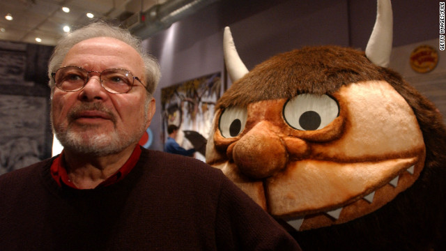 "Maurice Sendak stands with a character from his book ""Where the Wild Things Are."""