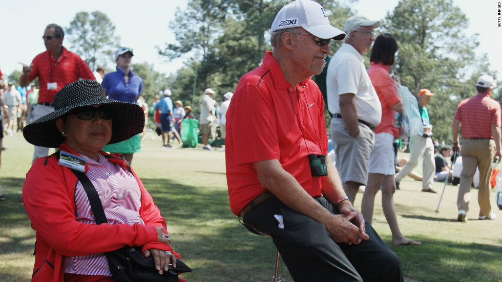 Quail Hollow was Woods' first outing since finishing 40th at the Masters, where he was watched by his mother Kultida (left) and Phil Knight, co-founder of one of his main sponsors, Nike.