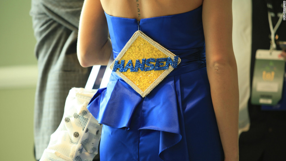 A punter displays her backing for the racehorse Hansen. As with most iconic events, it's usually the people who come to the event that make it.