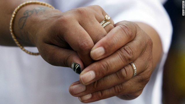 Ruth Johansen Diaz and Evelyn Johansen Diaz hold hands while exchanging rings during their wedding ceremony in Washington Square Park on July 26, 2011 in New York City.