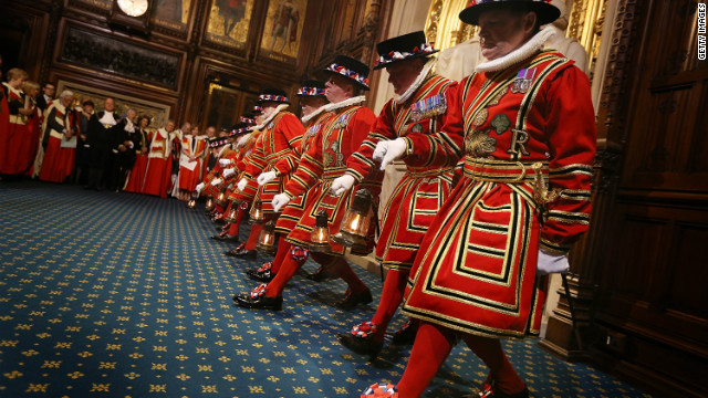 Yeomen of the Guard pick up oil lanterns as they prepare to conduct a ceremonial search in the Palace of Westminster.